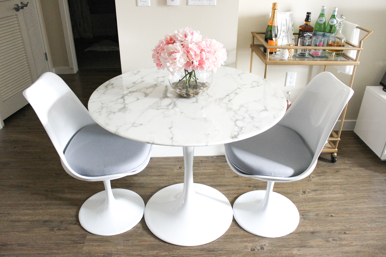 Faux marble table | White Dining Room | Gold Bar Cart | StyledByBlondie.com