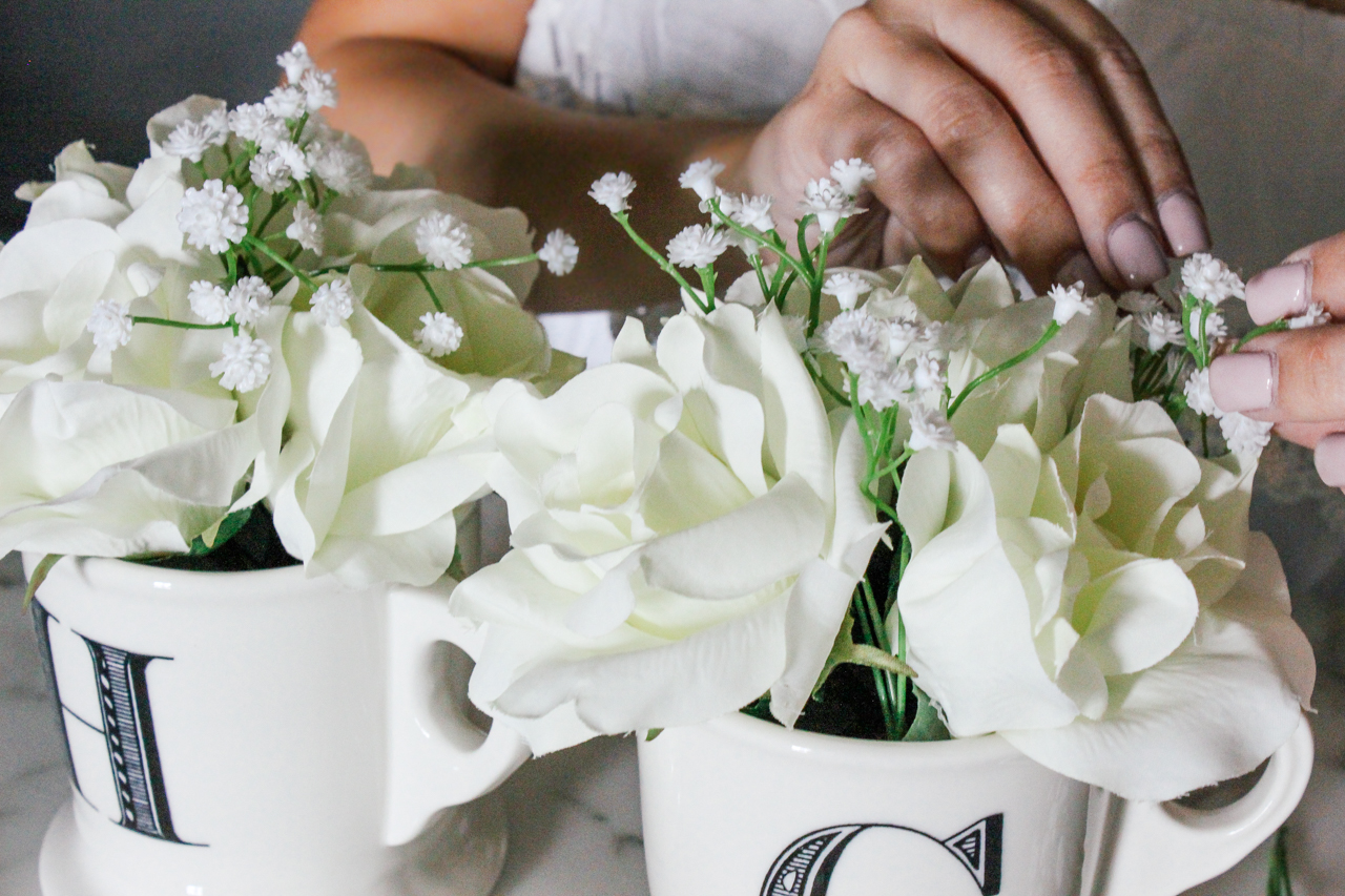 DIY Decor: Coffee cup filled with flowers | StyledByBlondie.com