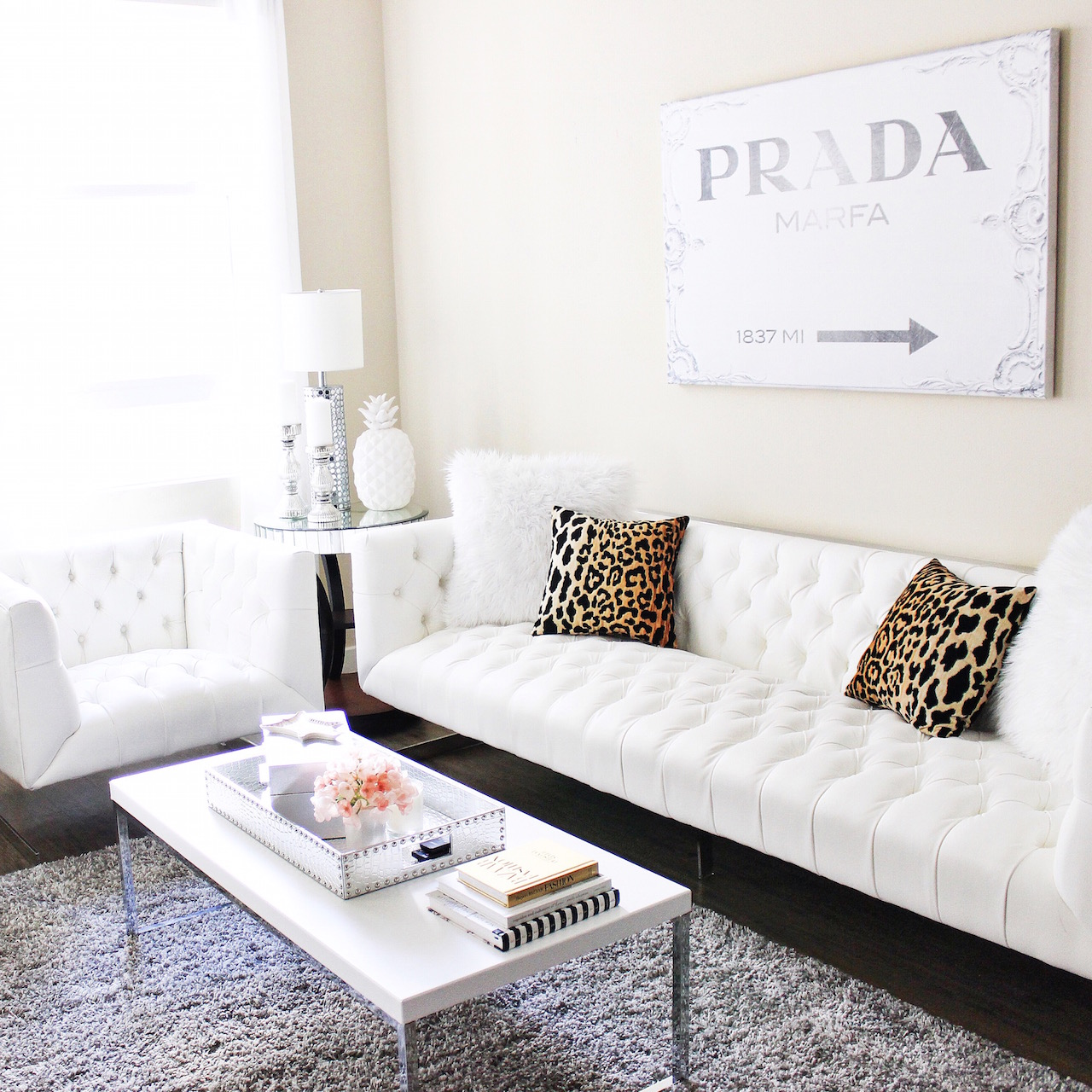 White Tuffed Couch | Leopard Pillows | Prada Canvas | White Living Room | StyledByBlondie.com