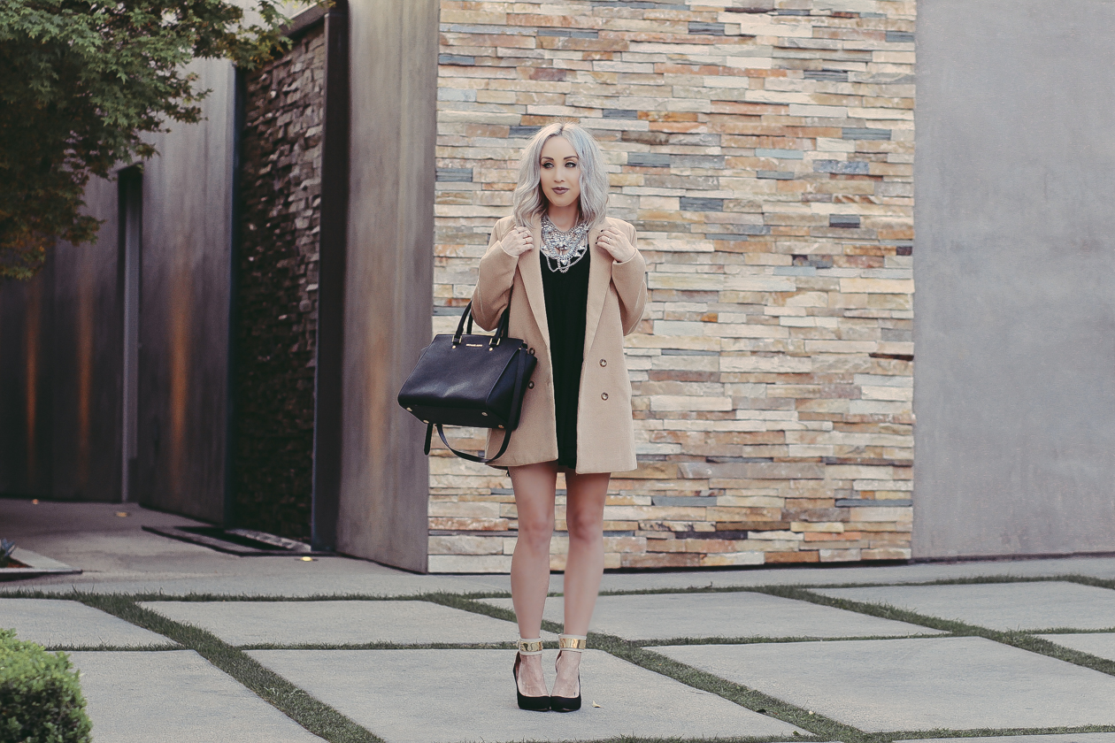 Camel Trench Coat, Black Babydoll Dress, Statement Necklace by @happinessbtq | BlondieintheCity.com