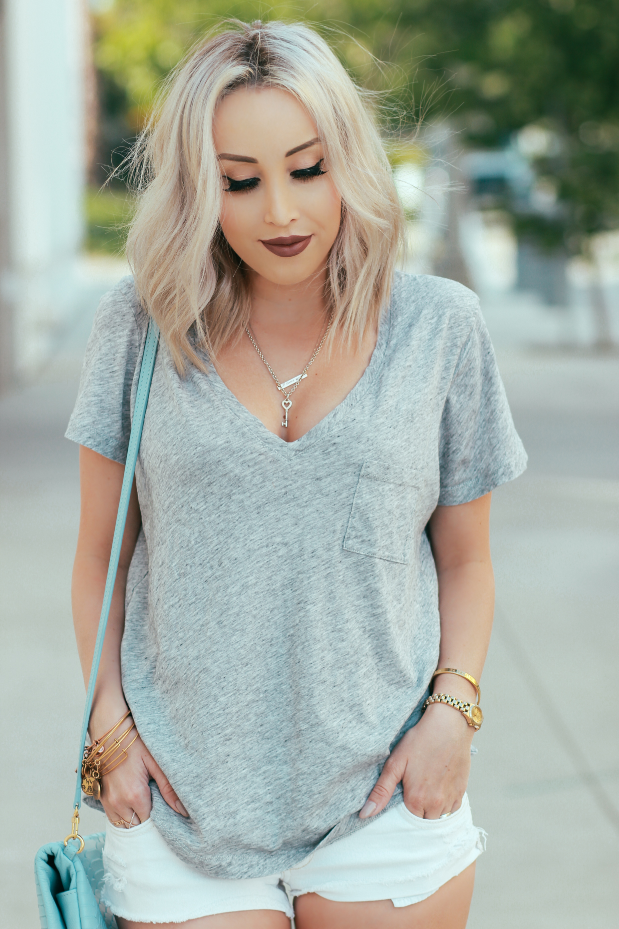 Blondie in the City   Perfect, Simple V-Neck Tee by @madewell - Crossbody Reversible Clutch by @giginewyork