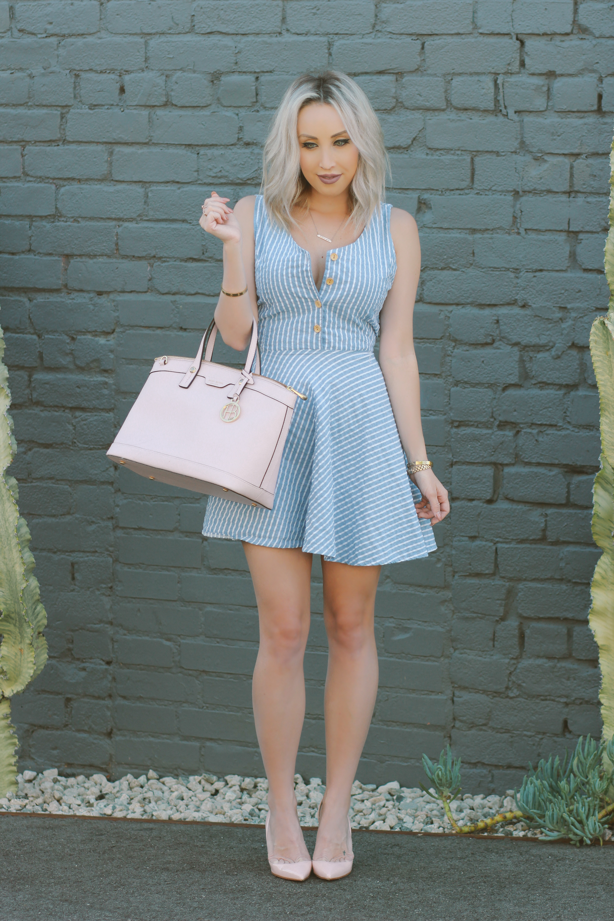 Blondie in the City | Striped blue and white dress, button up | Pink Henri Bendel Bag, Pink Christian Louboutin's