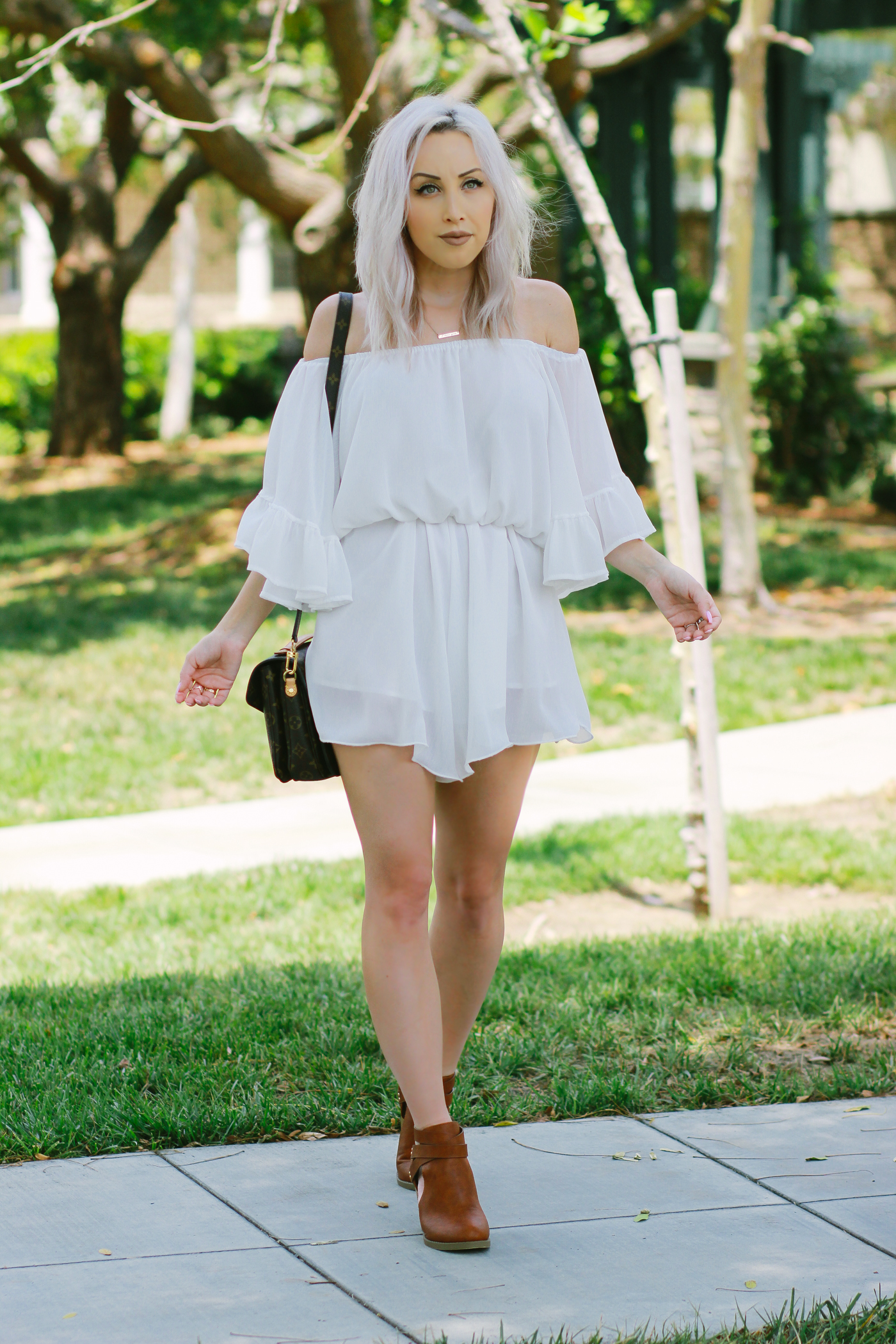 Blondie in the City | White Chiffon romper/playsuit from @chicwish | Brown Booties from @shoedazzle | Summer #OOTD