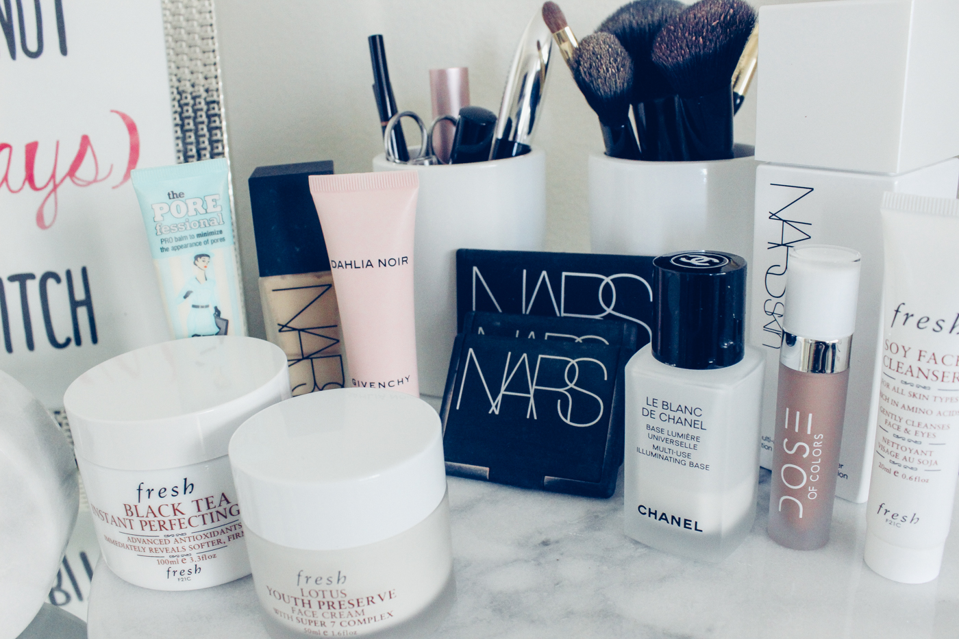 Blondie in the City | Marble Bathroom Styling | Makeup Products, NARS Makeup | Chanel Makeup | Black and White Bathroom Decor | White Marble Clock | White Marble Lazy Susan