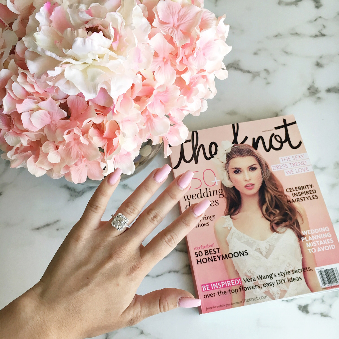 Blondie in the City | Instagram: @HayleyLarue | Engagement Ring | Radiant Cut Diamond Ring with Halo | The Knot Magazine