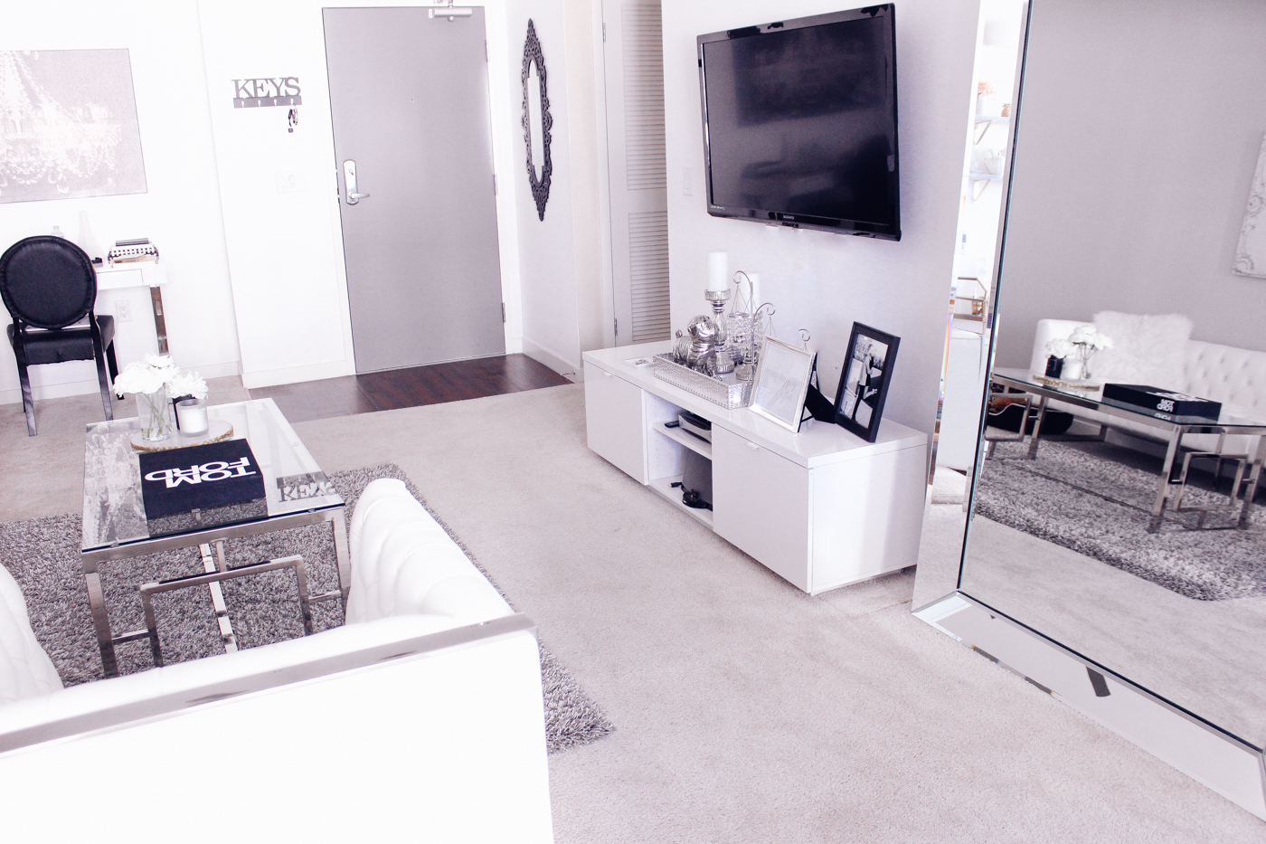 Blondie in the City   4 Reasons Why Your Home Needs A Leaner Mirror @ZGallerie   Home Decor, black and white home decor, black and white living room, white living room